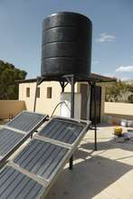 Solar tiles and water heater, installed on roof