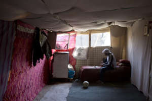Inside a tent home in Khan al Ahmar
