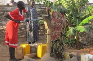 Women pumping water at WFSS compound