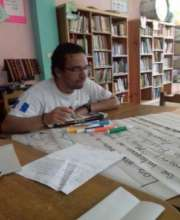 Young volunteer at library