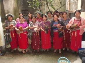 Ixil women show off their new chickens