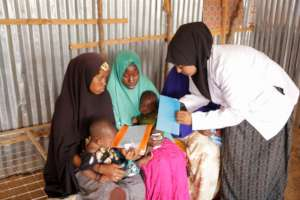 Our nurse speaks with women at Kaxda Health Center