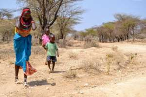 A mother and her family in search of water