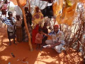 Said meets with a Somali family in their shelter