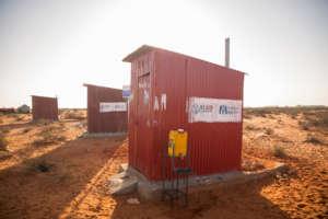 Three pit latrines at a Harhar village IDP camp