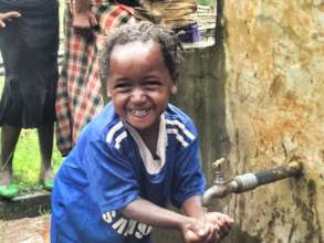 A child washes her hands at an Orbis-supported tap