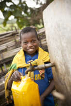 Boy collecting clean water