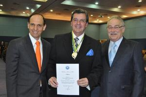 Dr. Paulo Novaes receiving Medal of Honor