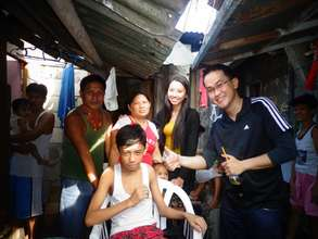 Paul and his family with AAI team in their home