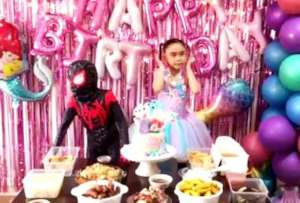 Super Brielle and brother Spider Boy celebrate