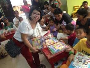 Children receive coloring books