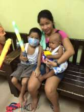 Children and their mom at the House of Hope