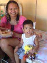 boy undergoing chemo with Mom and stuffed toy