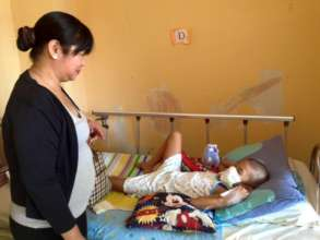 volunteer visiting child patients, House of Hope