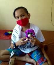 Happiness is a purple stuffed monkey