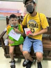 A dad and son receive Virtual Hugs of HOPE