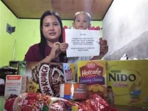 Mom and child are happy to receive care package!