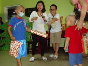 Children at House of Hope share Christmas gifts