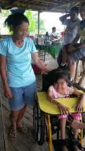 child of psod care with her mother