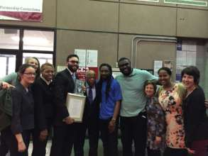 John Lewis and Andrew Aydin with Free Minds Team