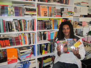 Sergio in the office with his favorite books
