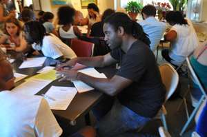 Volunteers respond to FM poetry at Write Night