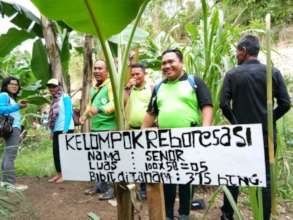 ASRI staff replanting at the Reforestation site