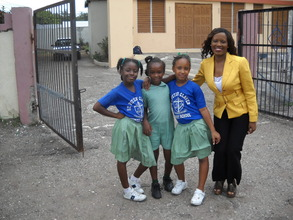 CEO Nikiki Bogle with students - St. Peter Claver