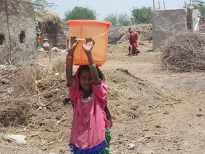 A Young girls of 9 years fetch drinking water