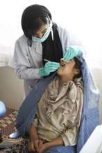 Adolescent girl visiting the dentist