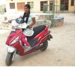 Laxmi with her new Scooter!