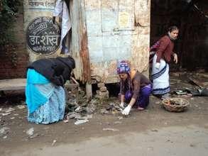 Our Volunteers helping the girls clean