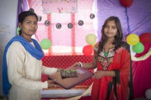 Maya(12th Grade) receiving prize from her teacher