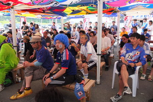 Viewing Game with J-league Flags on Ceiling