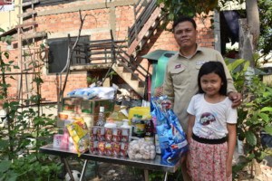 Deminer Rathana receiving essential supplies