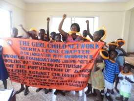 Anita Koroma with girls who have joined her clubs