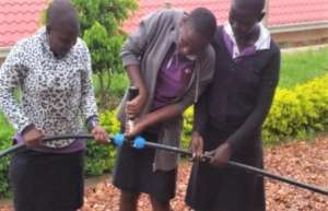 Girls working on automatic irrigation system