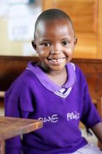 Annita in class at Nyaka Primary School