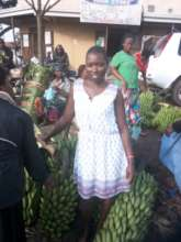 Agnes at her Matoke business in the market