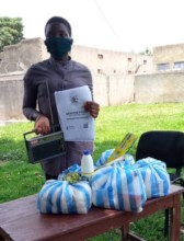 Daphine receives food aid and learning resources