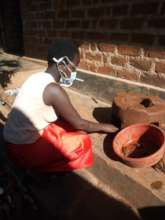 Viola making a cooking stove to sell