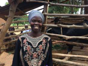 A member of a HEAL women's group with her goat.