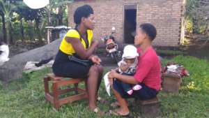 Adolescent mother receives support from mentor.