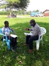 Study session with a Nyaka teacher and student