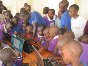 Students learning computer skills in new lab