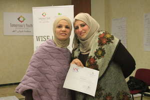 Rafeef (Rafeef's Cuisine) displays her certificate
