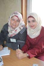 Entrepreneurs Dalal and Asmaa' smile at a training
