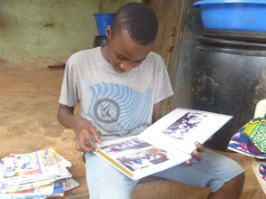 A boy appreciates his photo-album