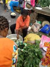 Jennet selling her vegetable in the market
