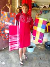 Milvert displaying some of the fabrics she bought